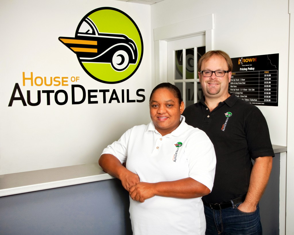 House of Auto Details Natalie Wilson and a man stand in the House of Auto Details lobby.