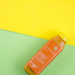 Enzymes juice product on colourful background.