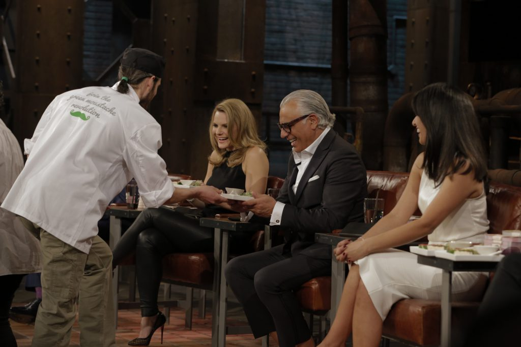 Green Moustache giving samples to the Dragon's on Dragons' Den.