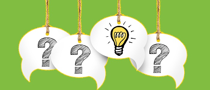 Question marks in speech bubbles with a lightbulb.