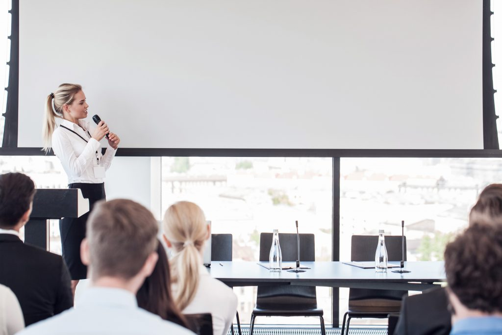 Person public speaking in a room.