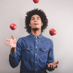 Man juggling apples.