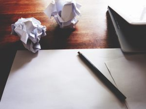 Crumpled paper on the desk.