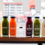 Ripe Juicery juices sitting on window